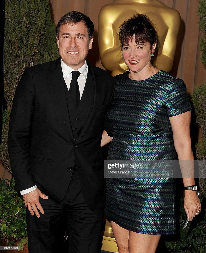 Director/writer David O. Russell (L) and producer Holly Davis attend the 85th Academy Awards Nominees Luncheon at The Beverly Hilton Hotel on February 4, 2013 in Beverly Hills, California.