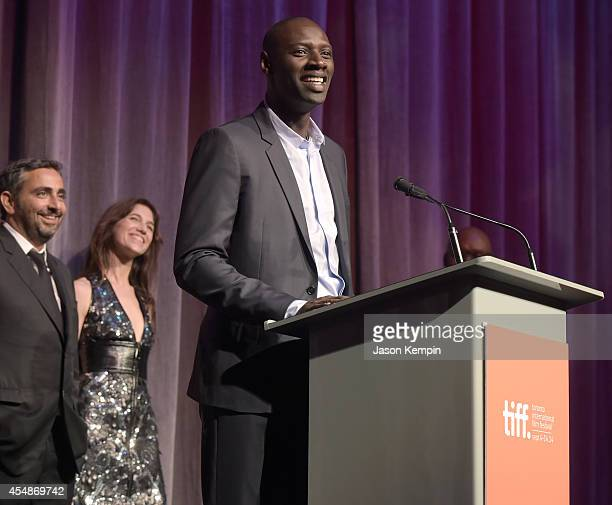 Director/writer Eric Toledano actress Charlotte Gainsbourg and actor Omar Sy attend the 'Samba' premiere during the 2014 Toronto International Film...