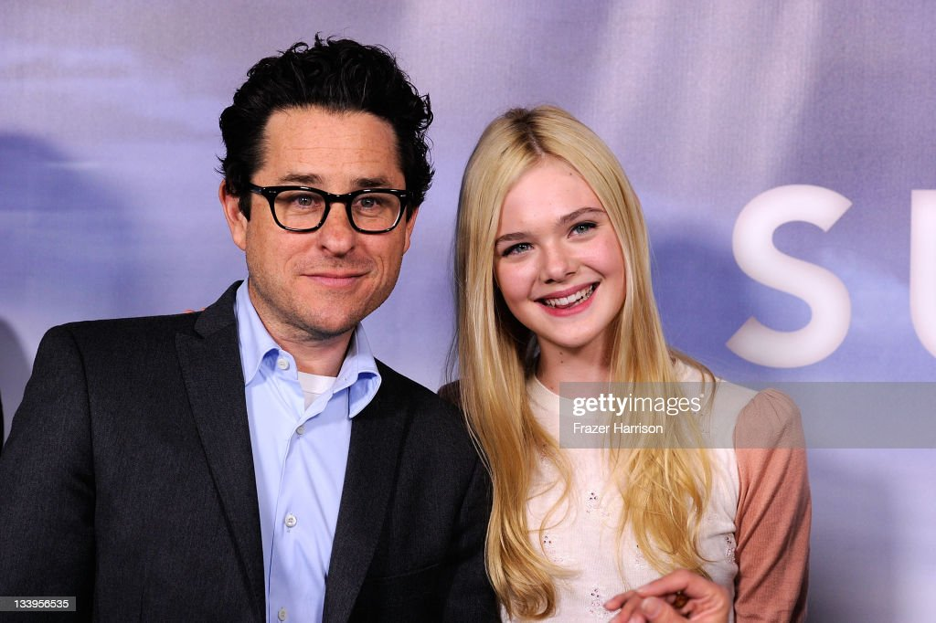 Director/writer J.J.Abrams and actress <a gi-track='captionPersonalityLinkClicked' href=/galleries/search?phrase=Elle+Fanning&family=editorial&specificpeople=2189940 ng-click='$event.stopPropagation()'>Elle Fanning</a> arrives at Paramount Pictures' 'Super 8' Blu-ray and DVD release party at AMPAS Samuel Goldwyn Theater on November 22, 2011 in Beverly Hills, California.