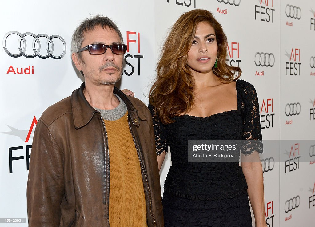 Director/Writer Leos Carax and actress Eva Mendes arrive at the 'Holy Motors' special screening during the 2012 AFI Fest at Grauman's Chinese Theatre on November 3, 2012 in Hollywood, California.