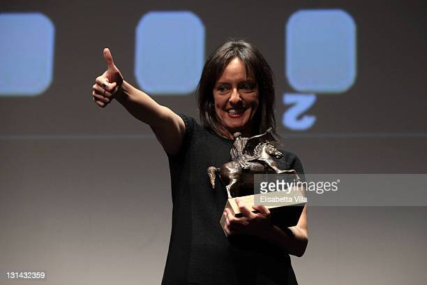 Director/writer Tania Hermida of 'In The Name Of The Girl' with her Marc' Aurelio award for films for children under 13 years old during the Closing...