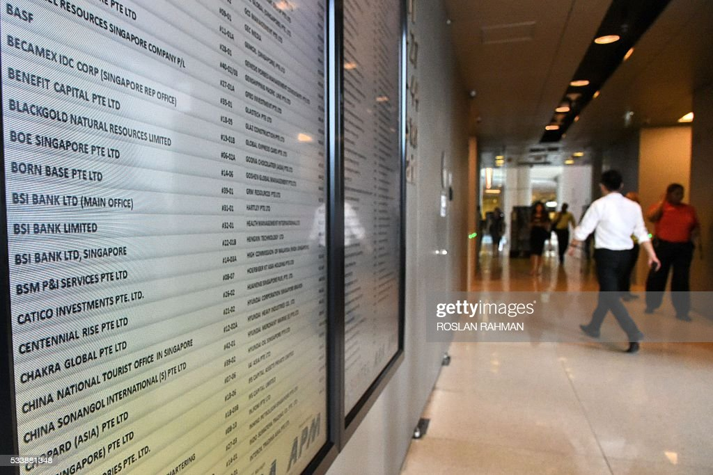 A directory board shows the office unit numbers for Swiss bank BSI (centre of column pictured at left) in Singapore on May 24, 2016. Singapore's central bank on May 24 said it was kicking out Swiss bank BSI, which has been linked to a global money-laundering scandal at Malaysia's state fund 1MDB that has embroiled Prime Minister Najib Razak. / AFP / ROSLAN