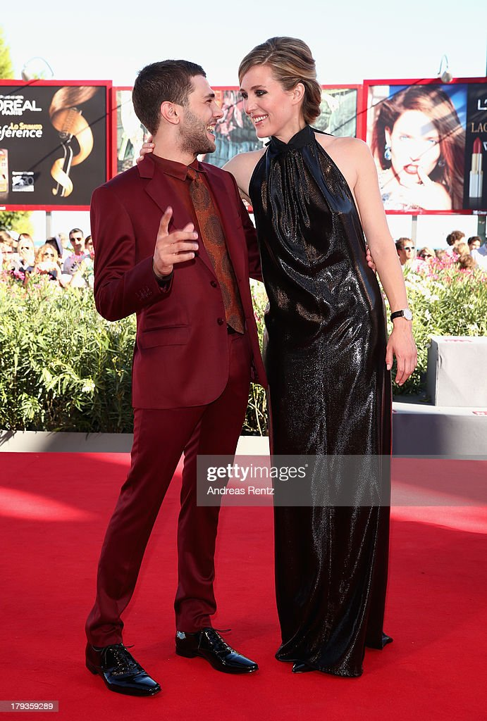 Direrctor Xavier Dolan and actress Evelyne Brochu, wearing a Jaeger-LeCoultre watch, at the 'Tom At The Farm' Premiere during the 70th Venice Film Festival at the Palazzo del Cinema on September 2, 2013 in Venice, Italy.