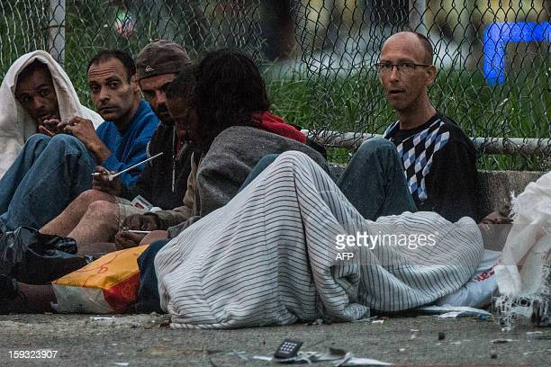 Dirk de Jong 50yearold Dutch tourist stays on a sidewalk among drug addicts at 'Crackolandia' a place where drug users gather to smoke crack in...