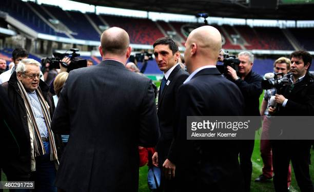 Dirk Dufner and Tayfun Korkut are seen standing in the HDIAnrea after a Press Conference as Korkut was announced as the new head coach of Hannover 96...