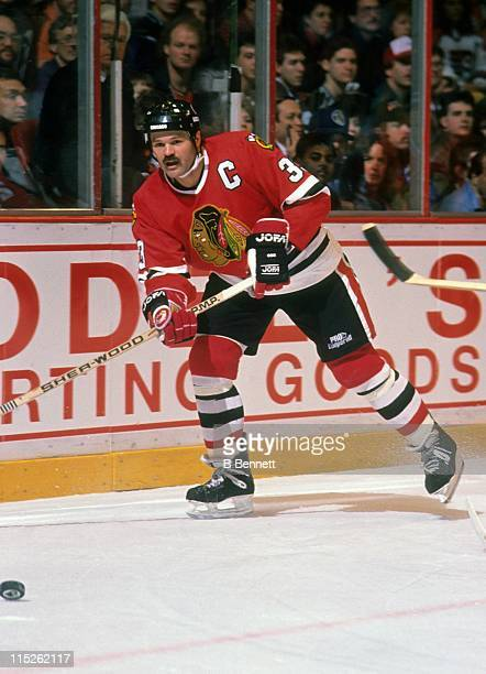 Dirk Graham of the Chicago Blackhawks passes the puck during an NHL game against the Philadelphia Flyers on January 11 1990 at the Spectrum in...