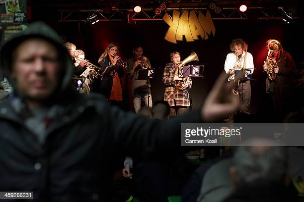 Dirk Hellenbrandt who has been homeless for the last 11 years cheers as a brass band perfoms on the stage at the 'Weihnachtsfest fuer alle' a...