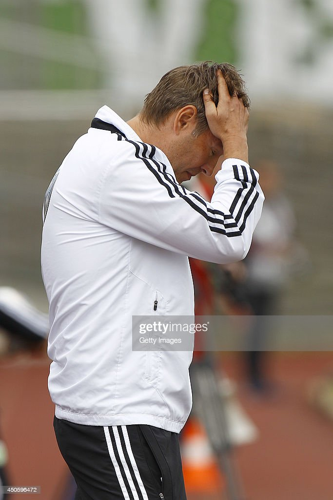 Dirk Kunert of Wolfsburg reacts during the A Juniors Bundesliga Semi Final between U19 VfL Wolfsburg and U19 Hannover 96 at Stadion am Elsterweg on June 14, 2014 in Wolfsburg, Germany.