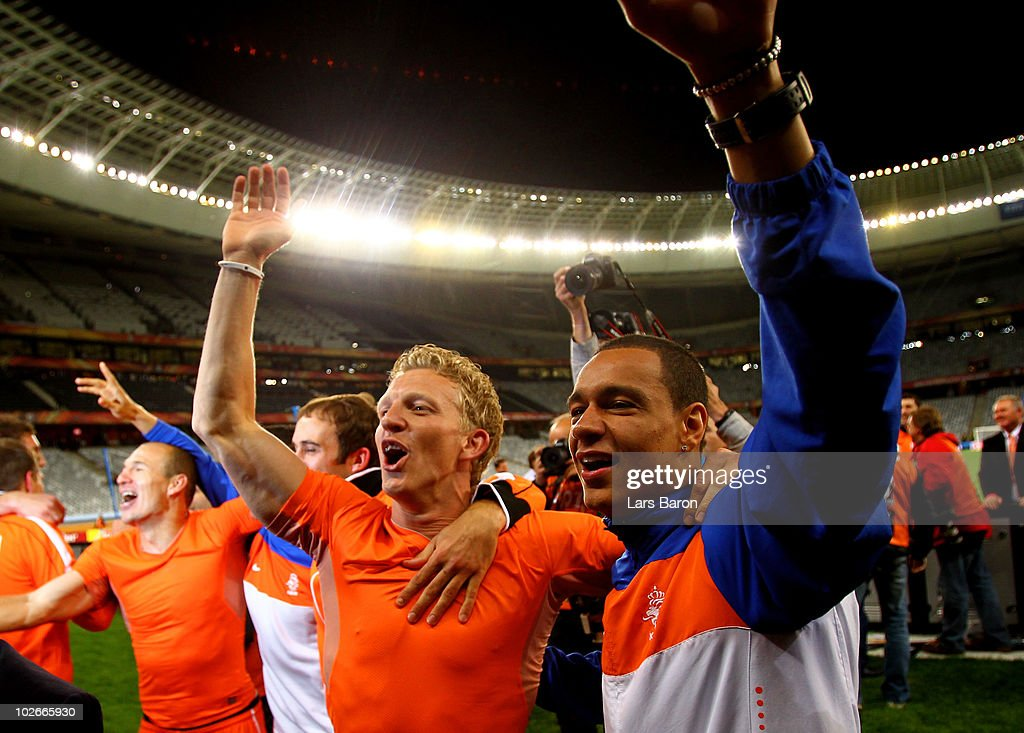 Dirk Kuyt and Gregory Van Der Wiel of the Netherlands celebrate victory and progress to the final during the 2010 FIFA World Cup South Africa Semi Final match between Uruguay and the Netherlands at Green Point Stadium on July 6, 2010 in Cape Town, South Africa.