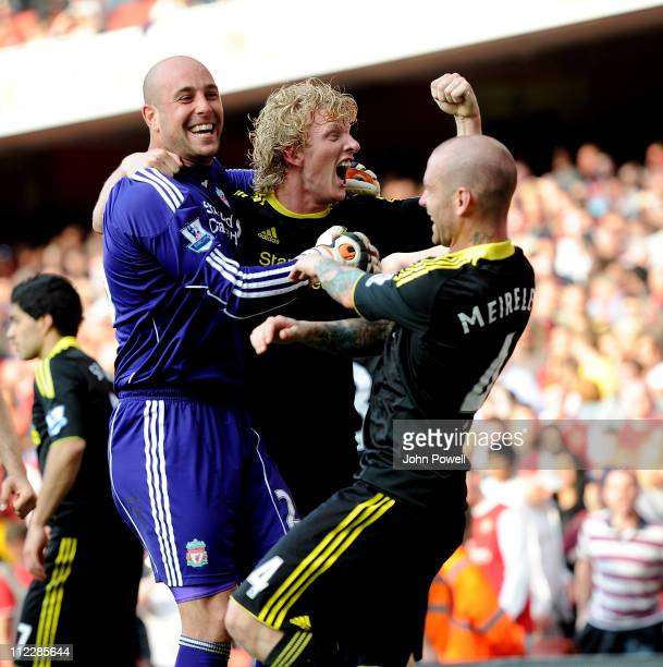 Dirk Kuyt and Pepe Reina of Liverpool celebrate at the end of the game during the Barclays Premier League match between Arsenal and Liverpool at The...