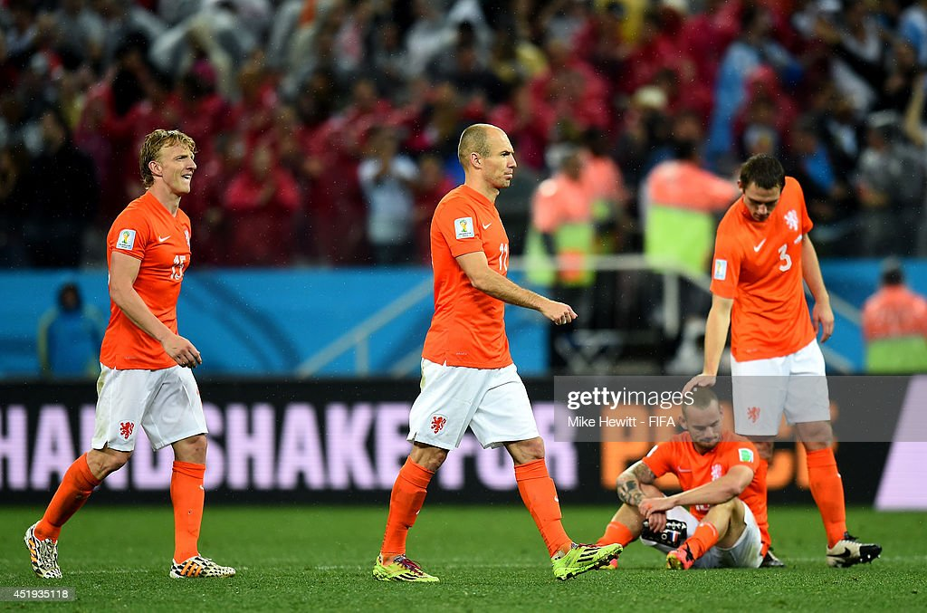 <a gi-track='captionPersonalityLinkClicked' href=/galleries/search?phrase=Dirk+Kuyt&family=editorial&specificpeople=538141 ng-click='$event.stopPropagation()'>Dirk Kuyt</a>, <a gi-track='captionPersonalityLinkClicked' href=/galleries/search?phrase=Arjen+Robben&family=editorial&specificpeople=194740 ng-click='$event.stopPropagation()'>Arjen Robben</a>, <a gi-track='captionPersonalityLinkClicked' href=/galleries/search?phrase=Wesley+Sneijder&family=editorial&specificpeople=538145 ng-click='$event.stopPropagation()'>Wesley Sneijder</a> and Stefan de Vrij of the Netherlands react after the defeat through the penalty shootout in the 2014 FIFA World Cup Brazil Semi Final match between Netherlands and Argentina at Arena de Sao Paulo on July 9, 2014 in Sao Paulo, Brazil.