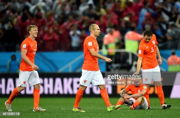 Dirk Kuyt Arjen Robben Wesley Sneijder and Stefan de Vrij of the Netherlands react after the defeat through the penalty shootout in the 2014 FIFA...
