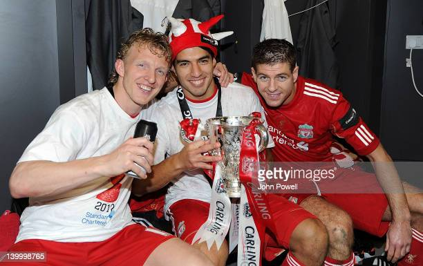 Dirk Kuyt Luis Suarez and Steven Gerrard of Liverpool celebrate with the trophy at the end of the Carling Cup Final match between Liverpool and...