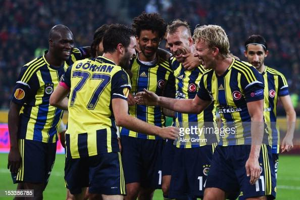 Dirk Kuyt of Fenerbahce celebrates his team's third goal with team mate Goekhan Goenuel and others during the UEFA Europa League group C match...