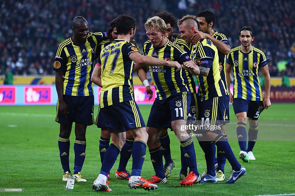 <a gi-track='captionPersonalityLinkClicked' href=/galleries/search?phrase=Dirk+Kuyt&family=editorial&specificpeople=538141 ng-click='$event.stopPropagation()'>Dirk Kuyt</a> of Fenerbahce celebrates his team's third goal with team mate Goekhan Goenuel and others during the UEFA Europa League group C match between Borussia Moenchengladbach and Fenerbahce SK at Borussia-Park on October 4, 2012 in Moenchengladbach, Germany.