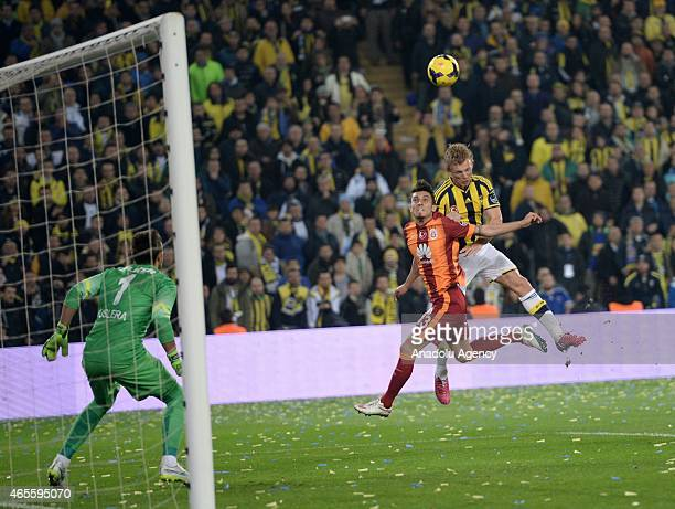 Dirk Kuyt of Fenerbahce in action against Alex Telles of Galatasaray during Turkish Spor Toto Super League derby game between Fenerbahce and...