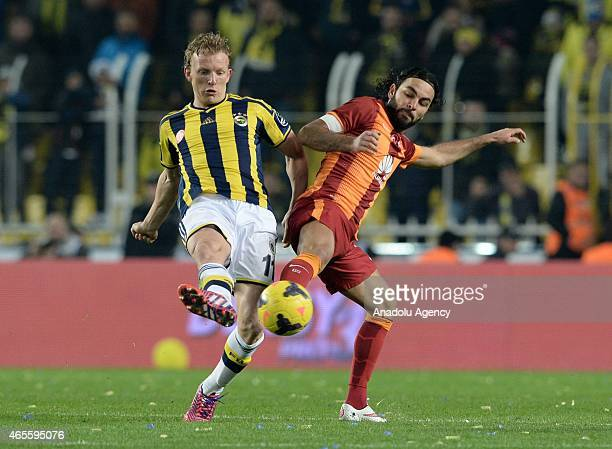 Dirk Kuyt of Fenerbahce in action against Selcuk Inan of Galatasaray during Turkish Spor Toto Super League derby game between Fenerbahce and...