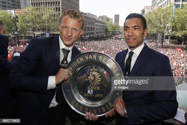 Dirk Kuyt of Feyenoord coach Giovanni van Bronckhorst with tropheeduring Feyenoord Rotterdam honored Eredivisie champions at the Coolsingel on May 15...