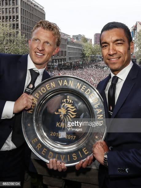Dirk Kuyt of Feyenoord coach Giovanni van Bronckhorst with the tropheeduring Feyenoord Rotterdam honored Eredivisie champions at the Coolsingel on...