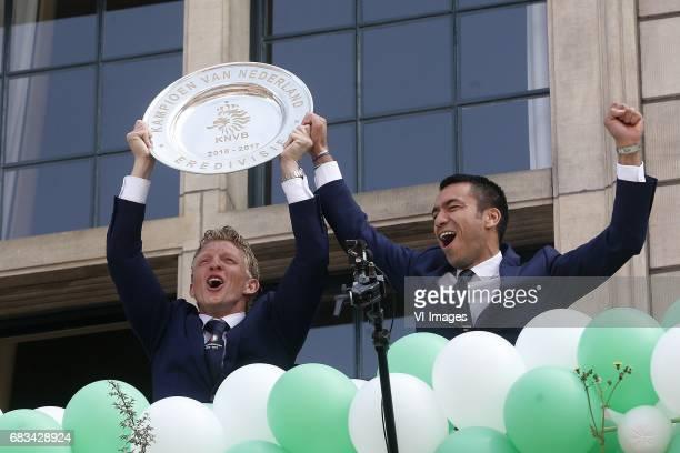 Dirk Kuyt of Feyenoord Coach Giovanni van Bronckhorstduring Feyenoord Rotterdam honored Eredivisie champions at the Coolsingel on May 15 2017 in...