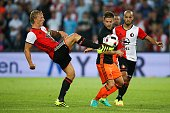Dirk Kuyt of Feyenoord Enzo Perez of Valencia CF during the preseason friendly match between Feyenoord and Valencia on July 23 2016 at the Kuip in...