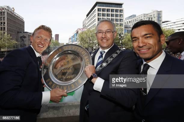 Dirk Kuyt of Feyenoord major Ahmed Aboutaleb of Rotterdam coach Giovanni van Bronckhorstduring Feyenoord Rotterdam honored Eredivisie champions at...