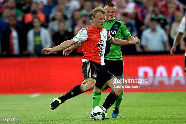 Dirk Kuyt of Feyenoord vies with Jordy Clasie of Southampton runs with the ball during the pre season friendly match between Feyenoord Rotterdam and...