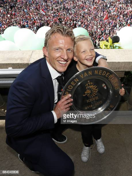 Dirk Kuyt of Feyenoord with his son Aidan and the tropheeduring Feyenoord Rotterdam honored Eredivisie champions at the Coolsingel on May 15 2017 in...