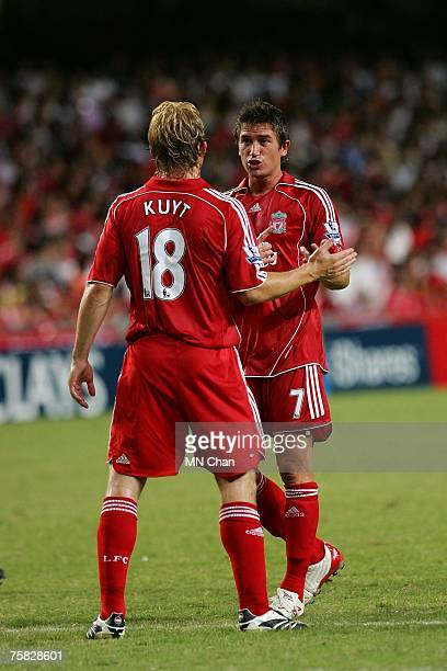 Dirk Kuyt of Liverpool and Harry Kewell of Liverpool speak during the preseason Barclays Asia Trophy final match between Liverpool FC and Portsmouth...