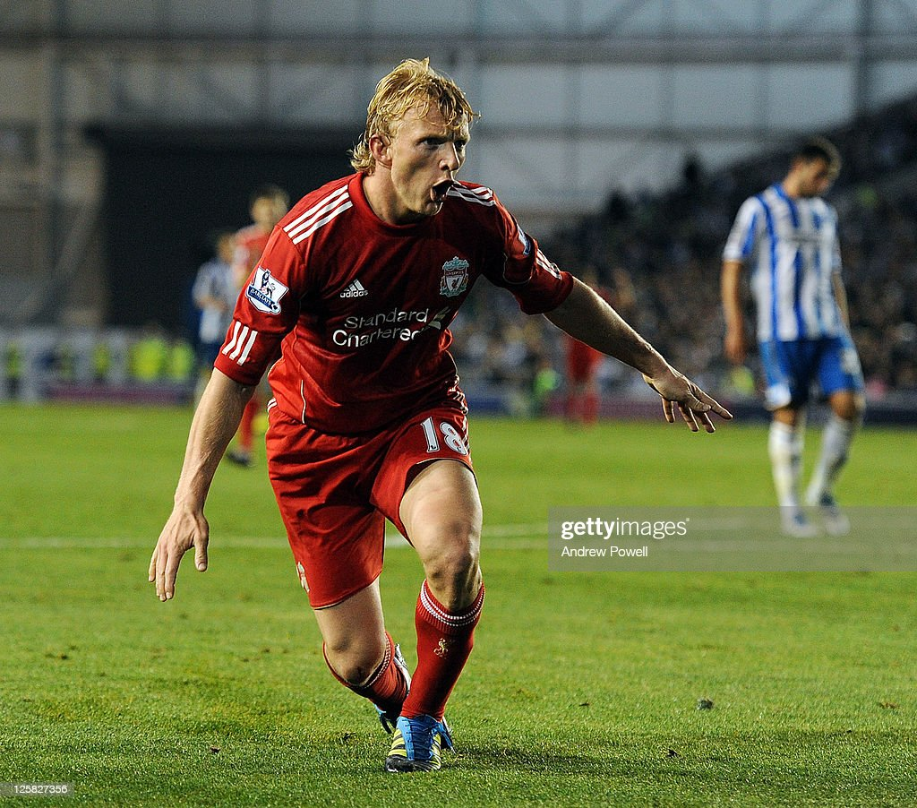 Dirk Kuyt of Liverpool celebrates after scoring the second Liverpool goal during the Carling Cup third round match between Brighton Hove Albion and...