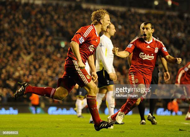 Dirk Kuyt of Liverpool celebrates scoring his team's second goal during the Barclays Premier League match between Liverpool and Tottenham Hotspur at...
