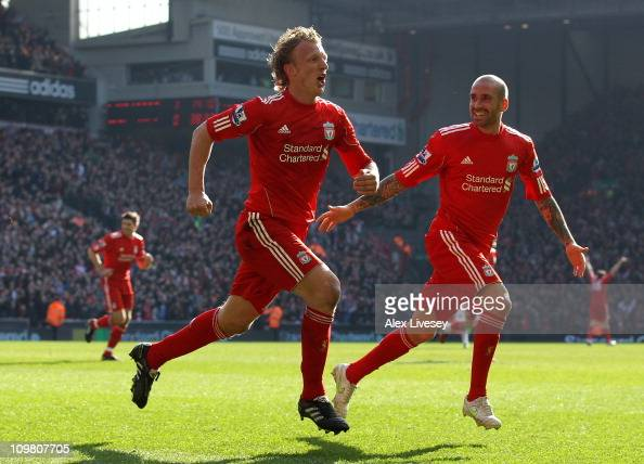 Dirk Kuyt of Liverpool celebrates scoring his team's second goal with team mate Raul Meireles during the Barclays Premier League match between...