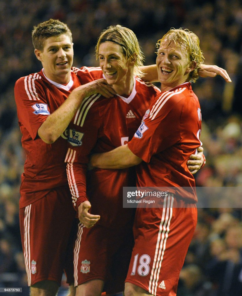 Dirk Kuyt of Liverpool celebrates scoring the opening goal with team mates Steven Gerrard and Fernando Torres during the Barclays Premier League...