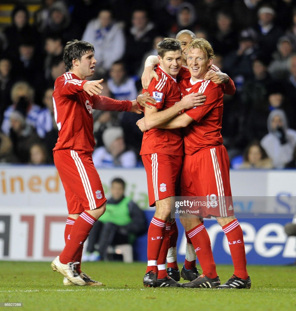 Dirk Kuyt of Liverpool celebrates with goal scorer Steven Gerrard after he scored the equalizing goal during the FA Cup 3rd round match between...