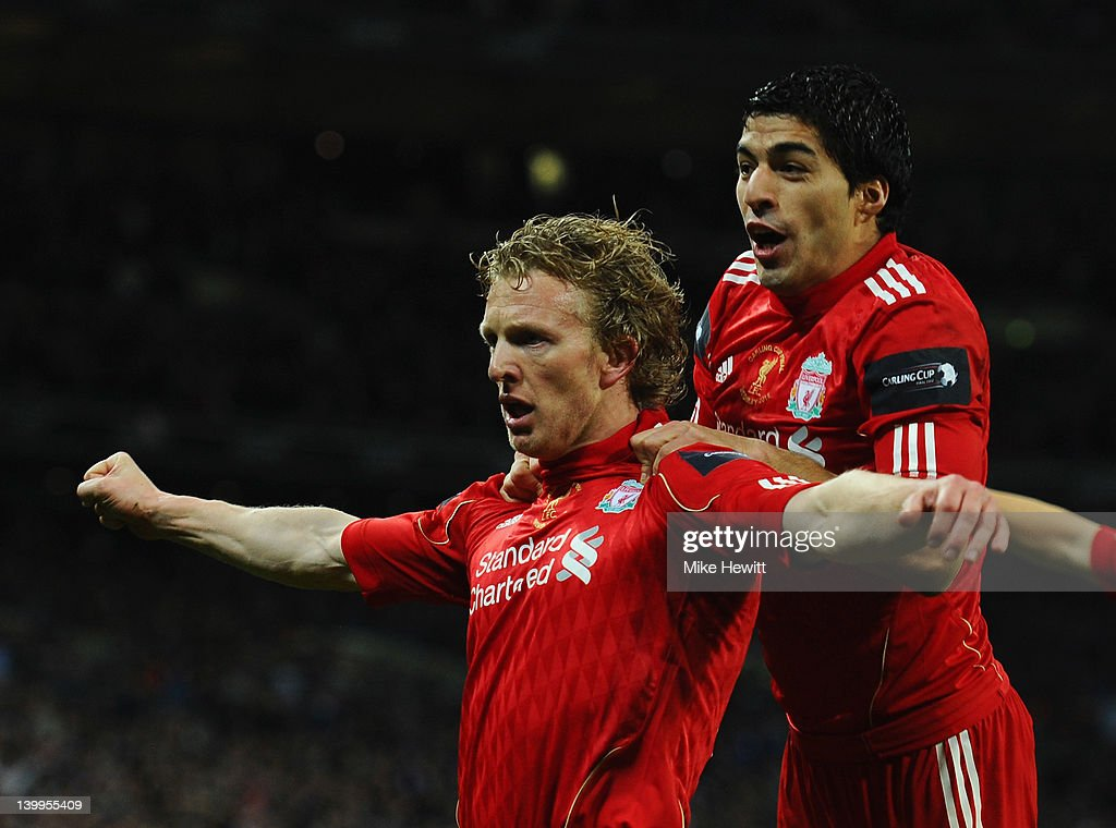 Dirk Kuyt of Liverpool celebrates with Luis Suarez as he scores their second goal during the Carling Cup Final match between Liverpool and Cardiff...
