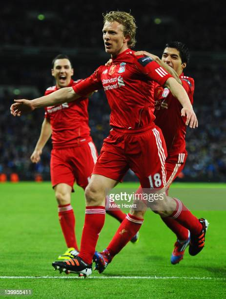 Dirk Kuyt of Liverpool celebrates with Stewart Downing and Luis Suarez as he scores their second goal during the Carling Cup Final match between...
