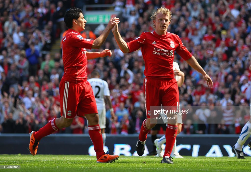 Dirk Kuyt of Liverpool celebrates with team mate Luis Suarez after scoring the second goal from the penalty spot during the Barclays Premier League match between Liverpool and Newcastle United at Anfield on May 1, 2011 in Liverpool, England.