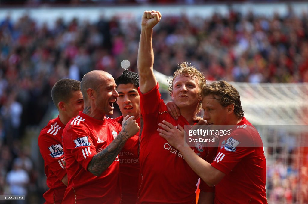 Dirk Kuyt of Liverpool celebrates with team mates after scoring the second goal from the penalty spot during the Barclays Premier League match between Liverpool and Newcastle United at Anfield on May 1, 2011 in Liverpool, England.