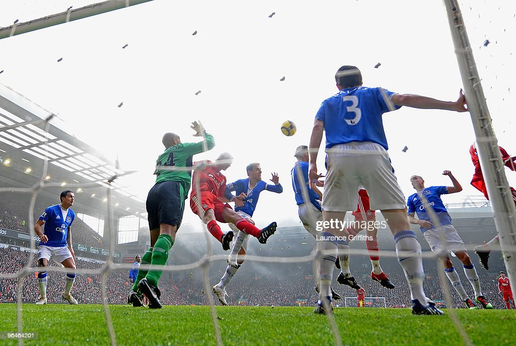 Dirk Kuyt of Liverpool scores the opening goal during the Barclays Premier League match between Liverpool and Everton at Anfield on February 6 2010...