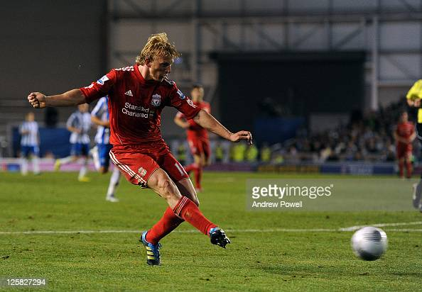 Dirk Kuyt of Liverpool scores the second during the Carling Cup third round match between Brighton Hove Albion and Liverpool at Amex Stadium on...
