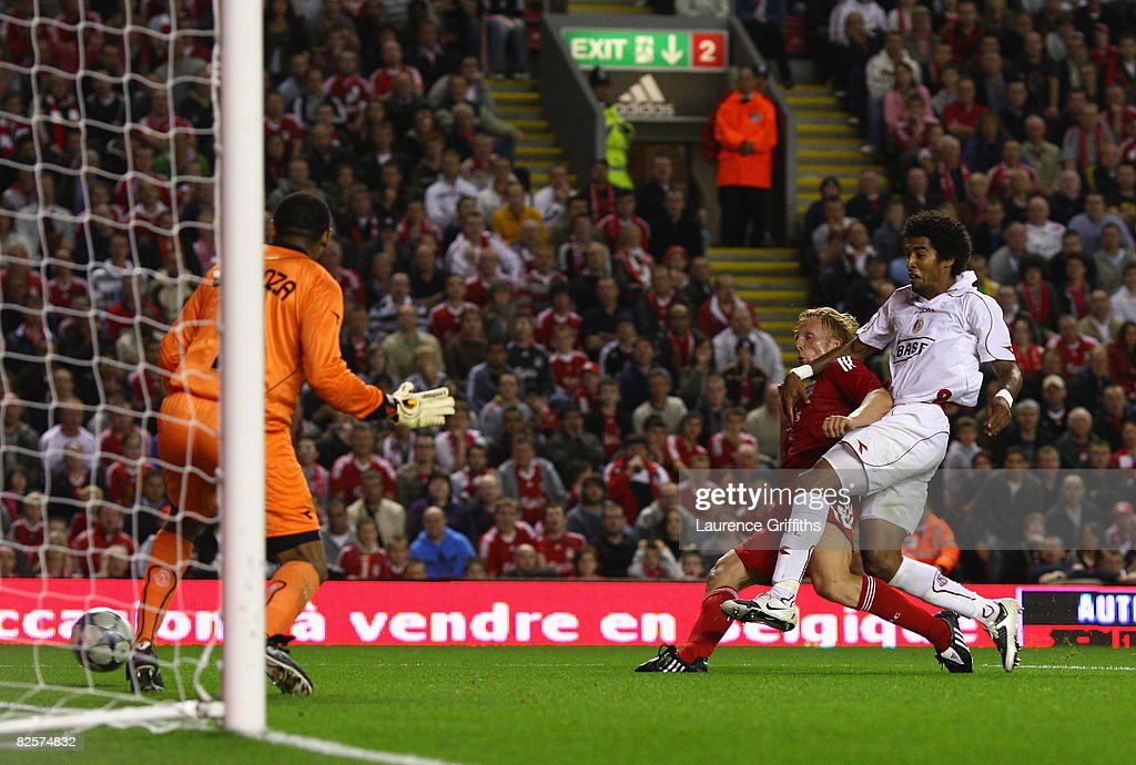Dirk Kuyt of Liverpool scores the winning goal during the UEFA Champions League Qualifier Third Round Second Leg Match between Liverpool and Standard...