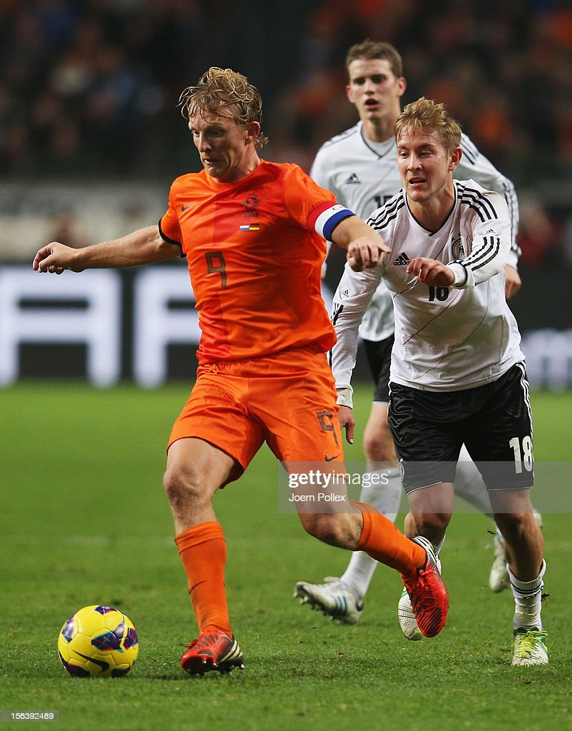 Dirk Kuyt of Netherlands and Lewis Holtby of Germany compete for the ball during the International Friendly match between Netherlands and Germany at Amsterdam Arena on November 14, 2012 in Amsterdam, Netherlands.