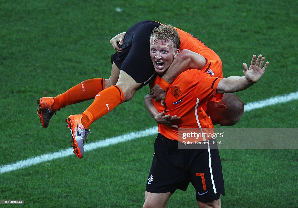 <a gi-track='captionPersonalityLinkClicked' href=/galleries/search?phrase=Dirk+Kuyt&family=editorial&specificpeople=538141 ng-click='$event.stopPropagation()'>Dirk Kuyt</a> of the Netherlands carries goalscorer <a gi-track='captionPersonalityLinkClicked' href=/galleries/search?phrase=Wesley+Sneijder&family=editorial&specificpeople=538145 ng-click='$event.stopPropagation()'>Wesley Sneijder</a> after he scores his side's second goal during the 2010 FIFA World Cup South Africa Round of Sixteen match between Netherlands and Slovakia at Durban Stadium on June 28, 2010 in Durban, South Africa.