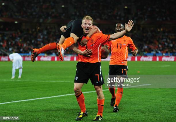 Dirk Kuyt of the Netherlands picks up Wesley Sneijder in celebration sfater he scored the second goal during the 2010 FIFA World Cup South Africa...