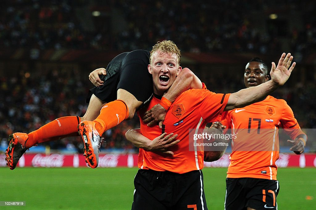 Dirk Kuyt of the Netherlands picks up Wesley Sneijder in celebration after he scored the second goal during the 2010 FIFA World Cup South Africa...