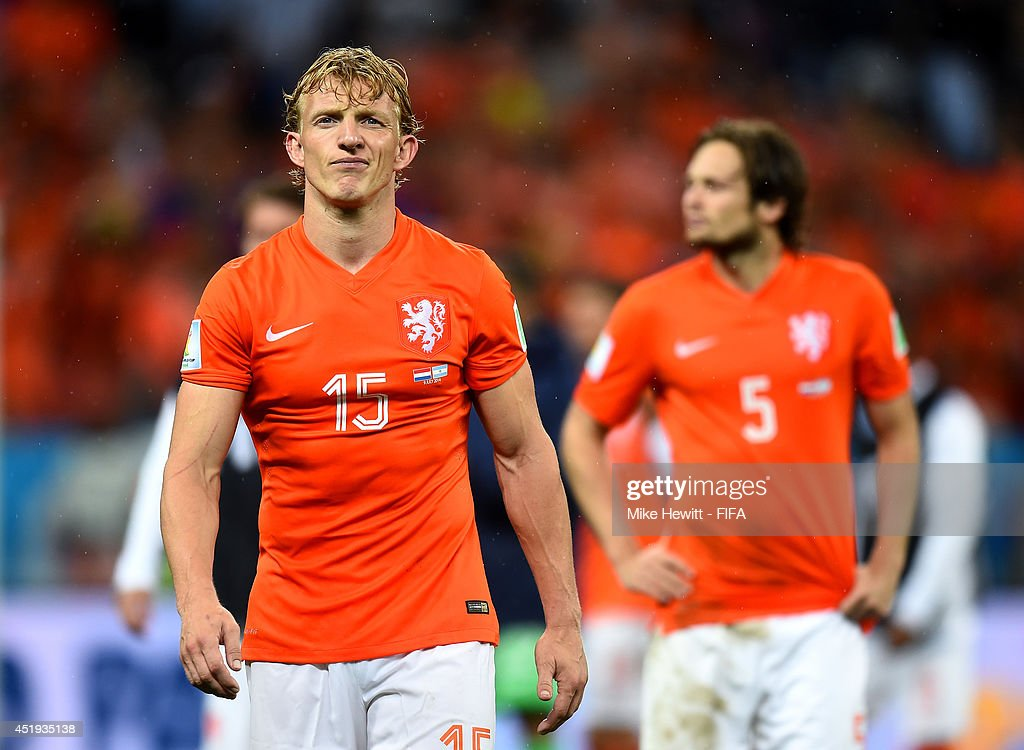 <a gi-track='captionPersonalityLinkClicked' href=/galleries/search?phrase=Dirk+Kuyt&family=editorial&specificpeople=538141 ng-click='$event.stopPropagation()'>Dirk Kuyt</a> (L) of the Netherlands shows his dejection while walking off the pitch after the penalty shootout defeat in the 2014 FIFA World Cup Brazil Semi Final match between Netherlands and Argentina at Arena de Sao Paulo on July 9, 2014 in Sao Paulo, Brazil.