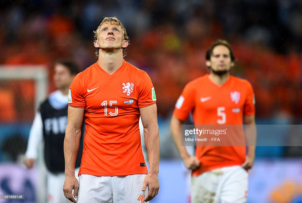 Dirk Kuyt of the Netherlands shows his dejection while walking off the pitch after the penalty shootout defeat in the 2014 FIFA World Cup Brazil Semi...