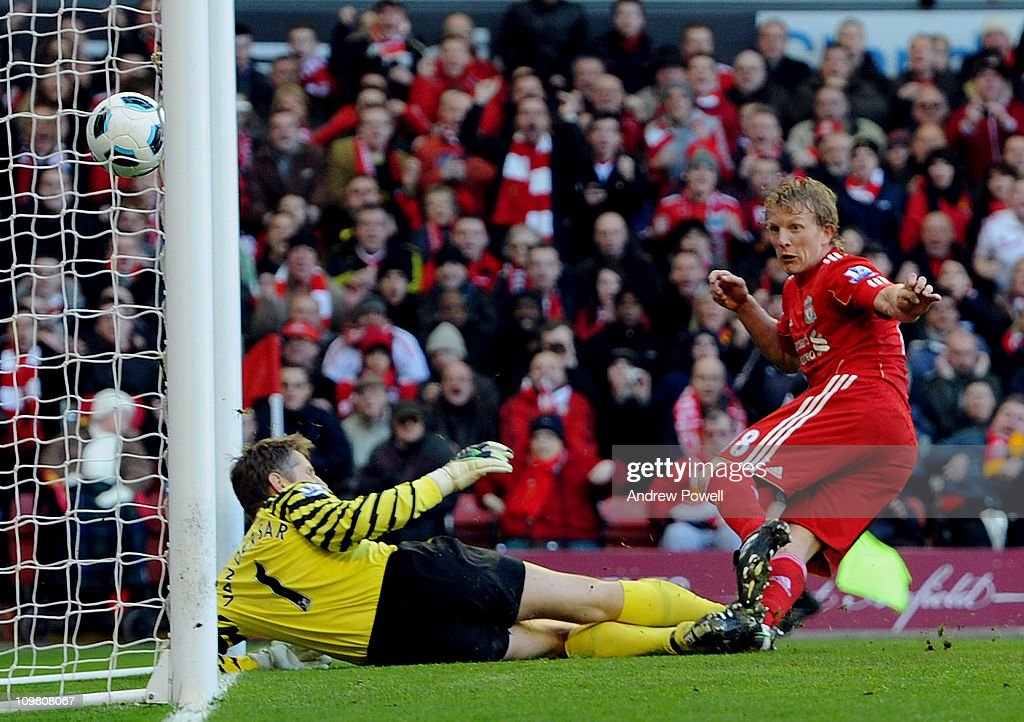Dirk Kuyt scores the third goal during the Barclays Premier League match between Liverpool and Manchester United at Anfield on March 6 2011 in...