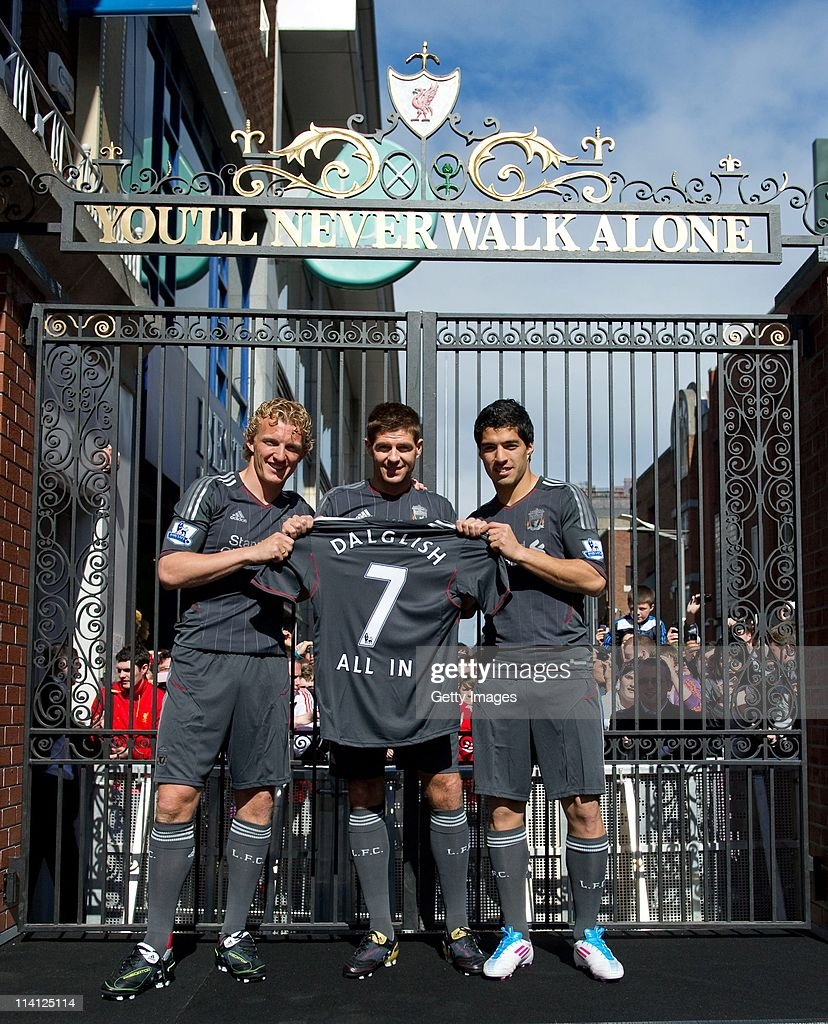 Dirk Kuyt Steven Gerrard and Luis Suarez of Liverpool FC launch the new Liverpool away kit in front of the Shankly Gates as adidas bring iconic...