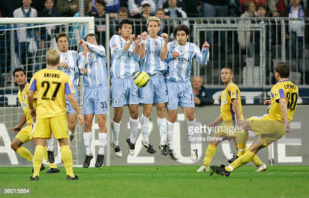 Dirk Lottner of Duisburg shoots a freekick against Munich during the DFB German Cup second round match between TSV 1860 Munich and MSV Duisburg at...